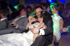 bride-and-groom-dancing-to-80's-music-at-wedding-at-friern-manor--in-brentwood-essex,-photographer